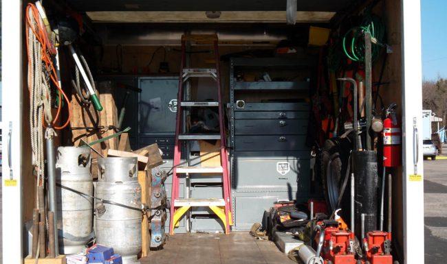 Photograph of inside rigging truck showing storage and equipment